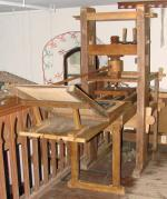 Reproduction of a Gutenberg press.