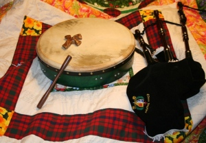 Brandi's pipes, bodhran and Holding Cross