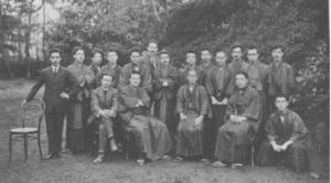 Kihachi Ozaki, standing next to chair, at 10-yr anniversary of Shirakaba journal
