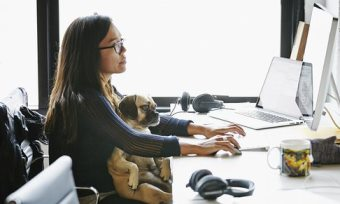 Woman with dog at work
