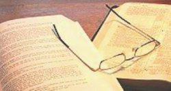 eyeglasses on books