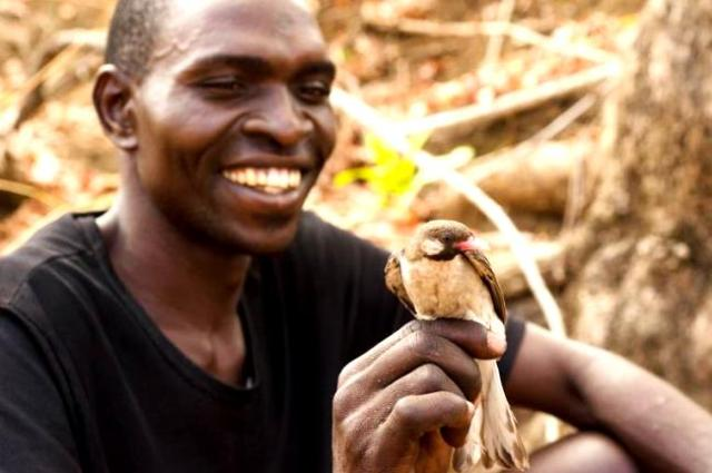 Yao hunter with honeyguide - Claire Spottiswoode
