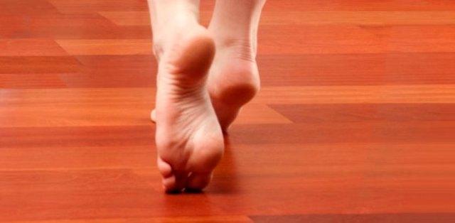bare-feet-on-wood-floor