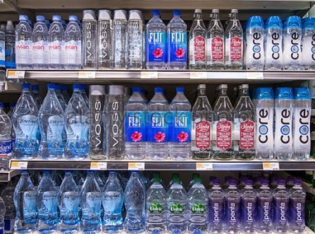 rows-of-name-brand-bottled-waters-on-shelves