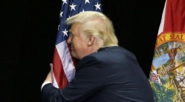 trumps_hugs_the_flag